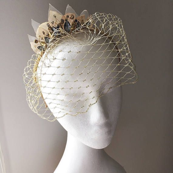 A beautiful and one of a kind gold and grey birdcage veil, which is perfect for an alternative wedding, for a special formal event or of course, as a unique races headpiece. If you are looking for a little golden statement headdress which is comfortable to wear, then this vintage style birdcage fascinator headband should definitely be in your top list. And if you are getting this as a wedding veil, in the future, simply turn up with it at a big do and wear it as a cocktail headdress! The…