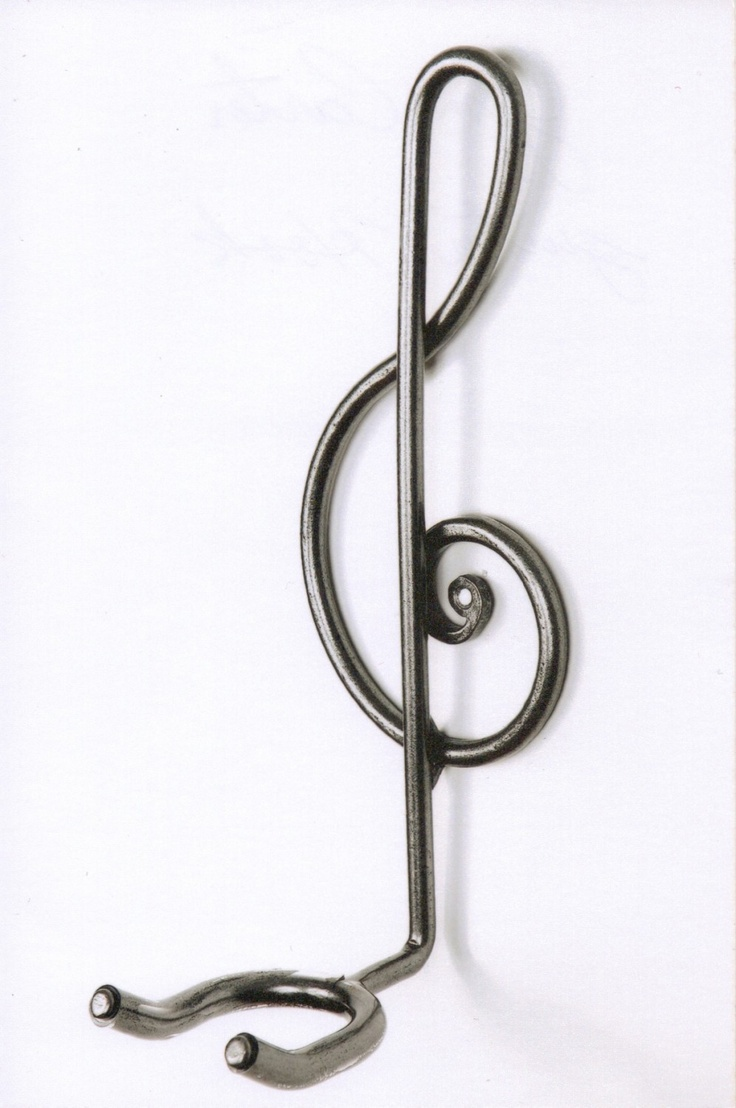 I have this exact guitar holder on my wall at the end of my bed.. (Jim Carter, artist/blacksmith) Artisans' Village Listing — Mariposa Folk Festival