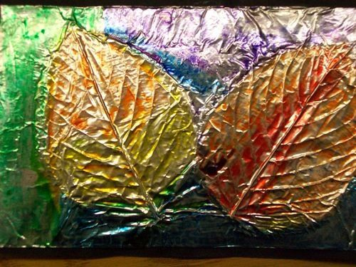 Super cool autumn leaf art project real leaves attached for Aluminium foil art and craft