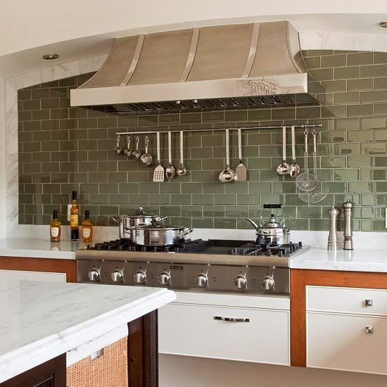 in an otherwise neutral kitchen a wall of gray green subway tiles adds a touch of color and shimmer subway tiles come in dozens of colors and are