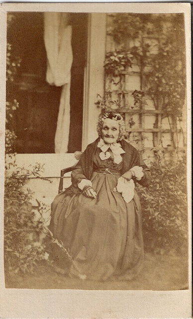 A heartwarmingly sweet little old Victorian (circa 1870) lady sitting outside amongst the rose bushes. It's amazing to look at this image and reflect on the fact that she was most likely born during the late 1700s. #Victorian #woman #grandma #1800s #19th_century #portrait