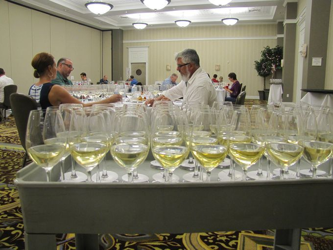 Samples of wine to be evaluated await some of the 21 judges Tuesday during the first day of competition at the New York Wine & Food Classic at the Watkins Glen Harbor Hotel.  BOB JAMIESON / Elmira Star-Gazette