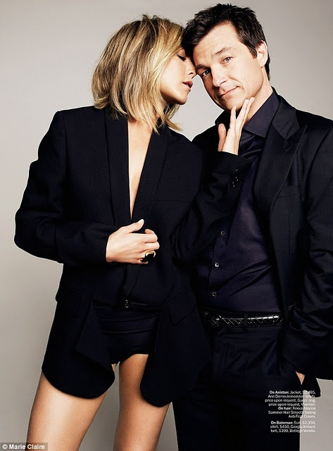 Image of Jennifer Aniston and Jason Bateman: The classic image of the confident man in suit, and sexy, unclothed woman desiring him.