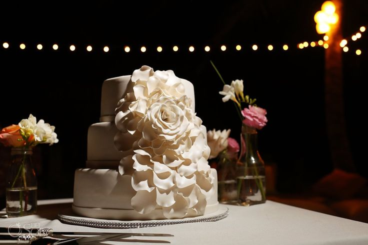 Elegant cake with floral design for a destination wedding at @La Zebra, Tulum in the Riviera Maya.  Mexico wedding photographers Del Sol Photography.