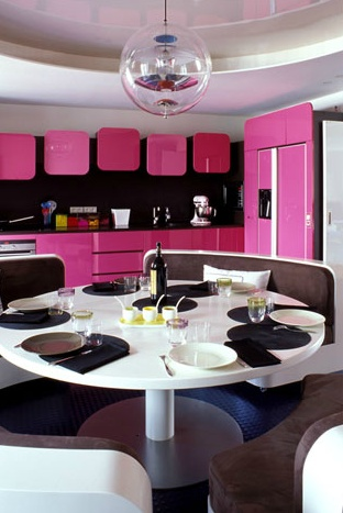 Retro pink kitchen cabinets by designers Laurent Buttazzoni and Frederic Lavaud from Buttazzoni & Associes