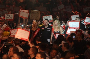The Premier League Darts reaches Round 12 on Thursday with the flamboyant roadshow heading to Liverpool with some play-off places still to be determined.
