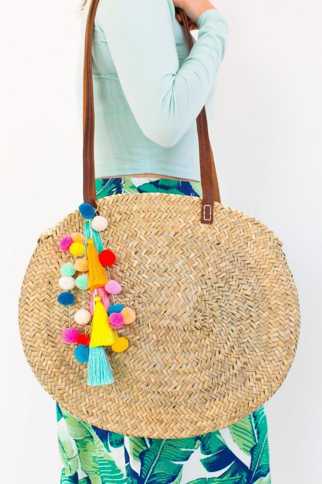 Give your wicker bag a final touch of pizzazz with vibrant tassels + fuzzy pom pom embellishments.