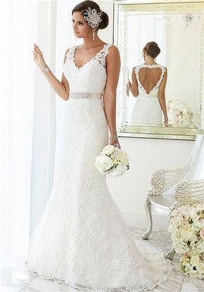 """For brides looking for that figure-flattering wedding dress, Essense of Australia has created this fit-and-flare gown with hand-sewn Diamante beading on Lace over Lavish Satin. At the top, the dress features illusion Lace shoulder straps covering a sweetheart neckline. At the knees, the dress blooms out and is finished with scalloped Lace on the hem and train. The back zips up under crystal buttons and features a heart-shaped keyhole back. Make this dress your own with a 1.5"""" Grosgrain ..."""