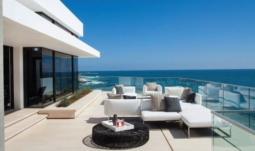 modern beach house with outdoor furniture