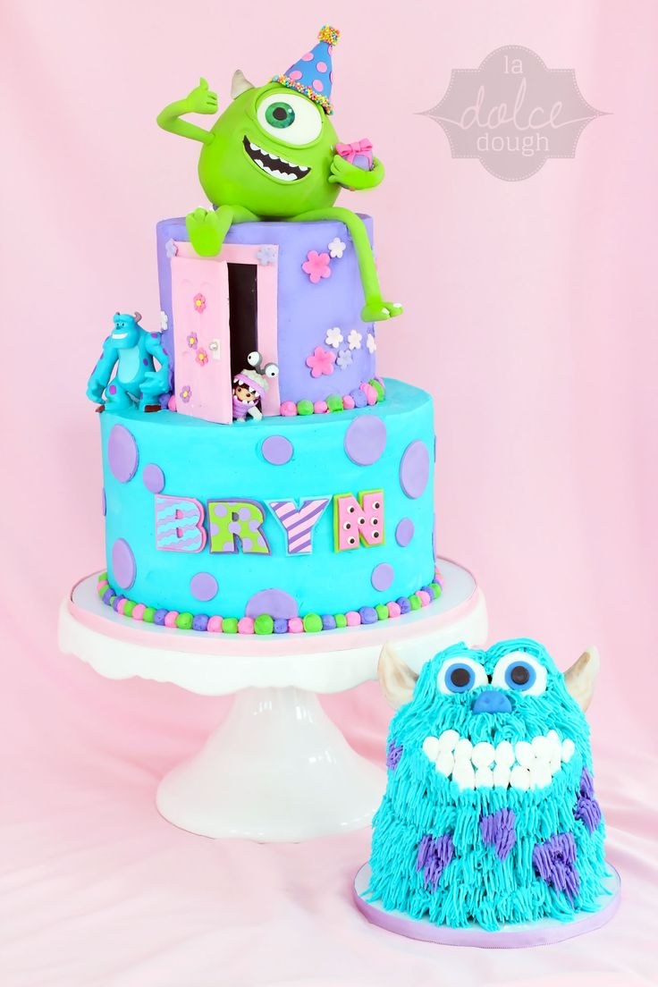 """Monster's Inc  - Monster's Inc 3rd Birthday. The Birthday girl wanted """"Monsters Inc. and Marshmallows""""! ... So, on her personal cake Sully's eyes and teeth are marshmallows.  Mike W. is RKT with 50/50 gumpaste/fondant.  Cake is covered with Buttercream and decorated with fondant accents."""