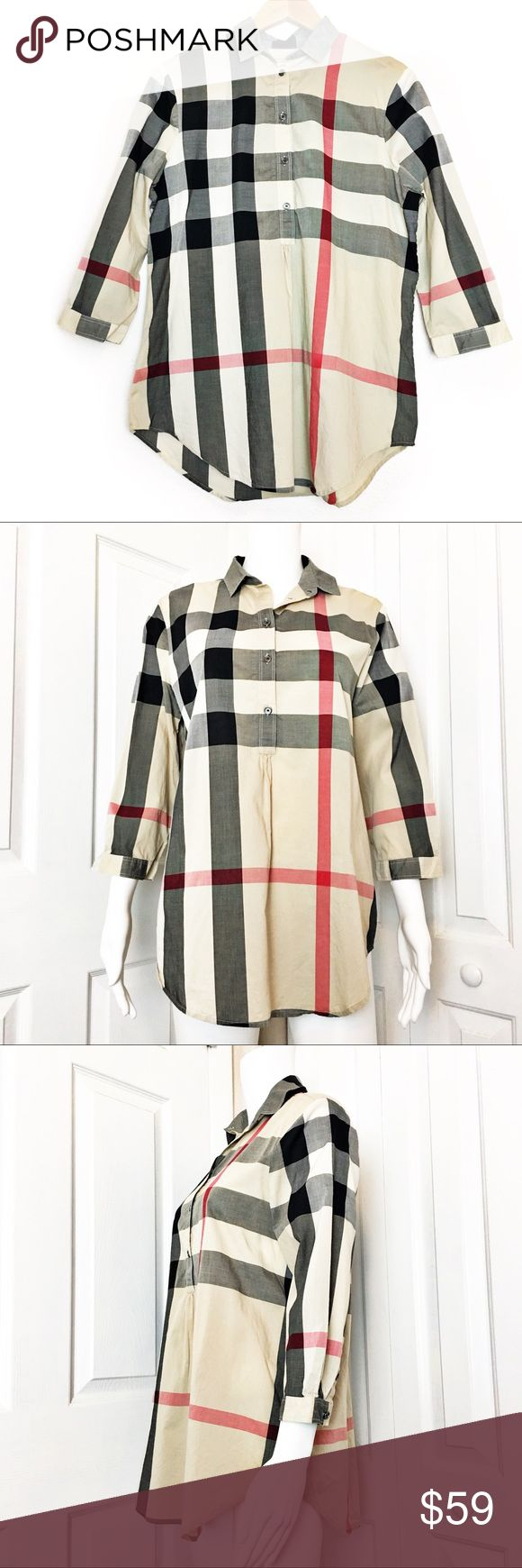"Burberry Tunic Top Authentic Burberry Brit Top.  Personally purchased from the Burberry store at Tampa international mall.  Classic plaid print with half button up.  Has 3/4 sleeves.  I cut the care tag but i did always have Top dry cleaned.  Measurements laid flat: ▪️pit to pit:  20"" ▪️length from top of shoulder to hem in from 28"" and back 30"" ▪️condition:  pre-owned excellent condition *Measurements are approximate. Burberry Tops Tunics"