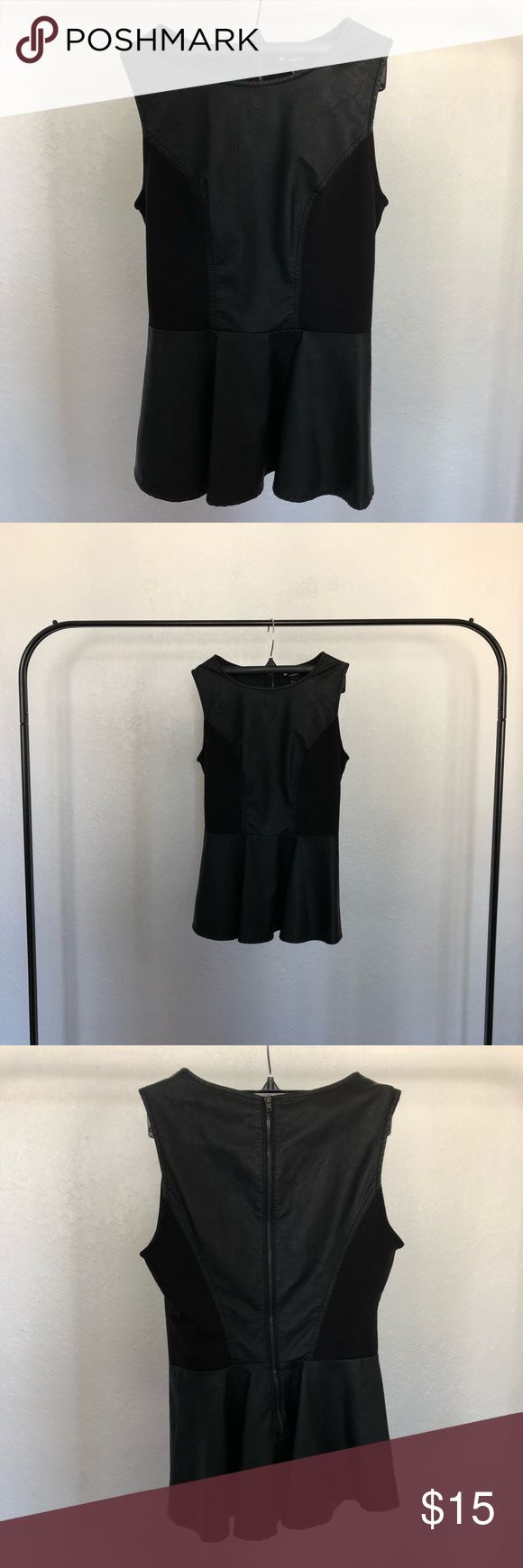 Faux Leather Peplum Top by Forever21 Faux Leather Peplum Top by Forever21.  Item is in a size 2 or extra small.  No wear or tear.  Top is still in perfect condition. Forever 21 Tops Blouses