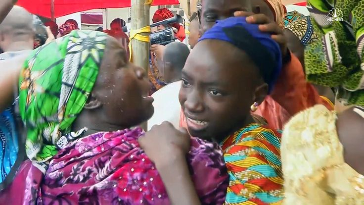 Twenty-one​ Nigerian school girls who were kidnapped by the Islamic militant group Boko Haram were reunited with their parents on Sunday.