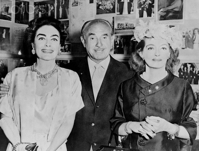 Joan Crawford, Louis B. Mayer, and Bette Davis, enjoying the success of 'Whatever Happened to Baby Jane', 1962.