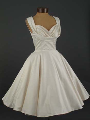 "The Trashy Diva 50s inspired ""Honey"" dress recreated for their Bridal Collection in an antique white satin finish cotton. Will make a stunning informal wedding dress or reception dress."