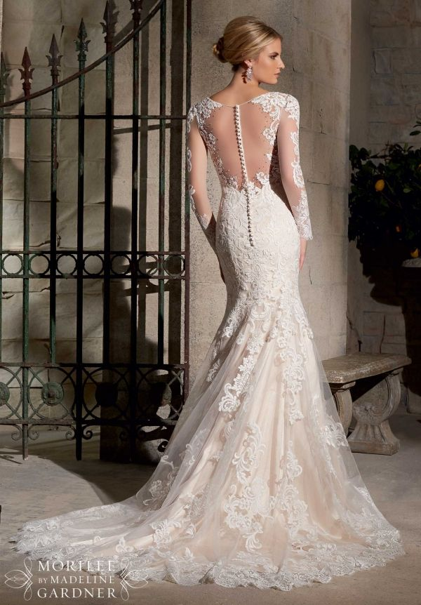Gorgeous Mori Lee gown with lace on illusion sleeves and sexy back.  Mori Lee Style 2725 coming to Cherry Blossom Bridal for Spring 2015.  Call (202) 544-2400 to request an appointment.