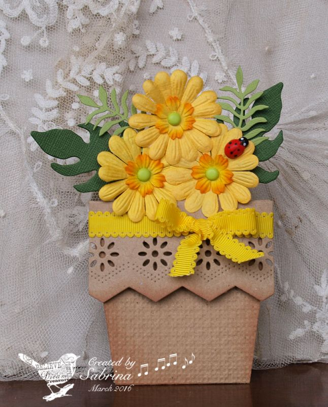 This is for Angie's Sunshine Box VSN challenge. If I didn't receive these actual Primas as a surprise RAK once, I got something very similar and I thought they were perfect for her challenge. I used the [url=http://www.splitcoaststampers.com/resources/tutorials/flowerpotpocket/][color=orange]Flower Pot Pocket Card[/color][/url] tutorial, making my base from kraft, and decorating it with a Spellbinders Edgeabilites set, and embossing the front with SU's Square Lattice ef. The foliage is…