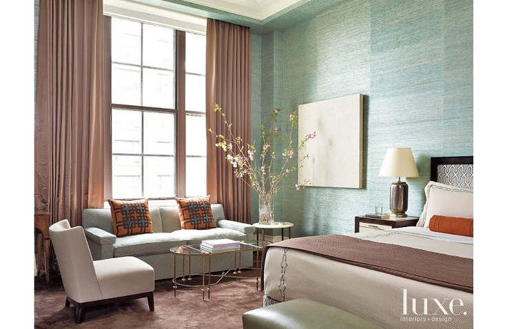 An aqua grass-cloth wallcovering from Phillip Jeffries sets the palette for this master bedroom designed by Philip Gorrivan.