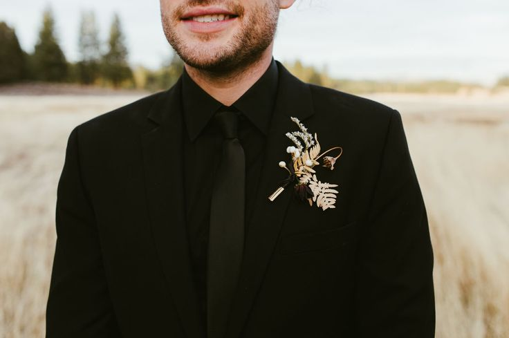 modern boutonniere groom in all black