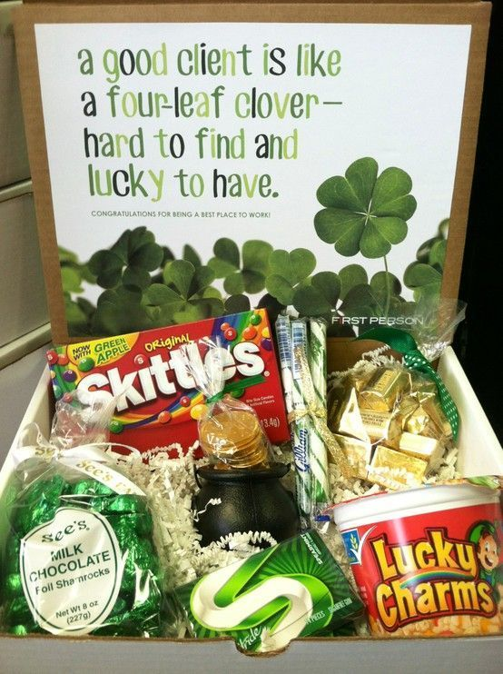 """Lucky St. Patrick's Day gift - A good client is like a four-leaf clover, hard to find and lucky to have!"""" Box includes: Skittles, See's Shamrock chocolates, Lucky Charms, green gum, gold nuggets, stripped candy sticks, and gold coins in a cauldron"""
