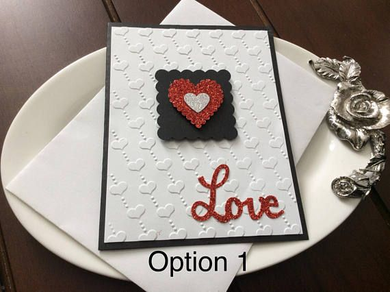 These are all handmade Valentine's Day cards. There are several designs to choose from. Some of the cards feature an embossed background and beautiful glittery hearts and others have layered colored paper with a heart design. Please let me know if you have any questions