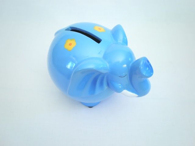 Elephant moneybox - A Very attractive small gift. Each elephant has a flower pattern painted randomly across the body. The trunk is up and we all know this means good luck to those who deposit their coins. There is a rubber stopper on the base to access coins and the elephant is ceramic. This item is perfect for decorating a windowsill.