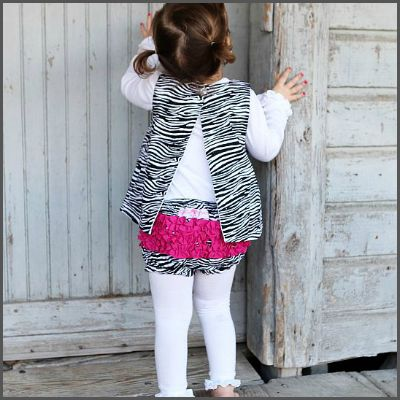 Zebra Print Woven RuffleButt. With it's fun and frilly style, the RuffleButt nappy cover adds a touch of innocence to any outfit. With a 100% cotton body and anti-wrinkle ruffles, this sweet zebra print bloomer is nothing but the best for your baby girl! Covered front to back in a super-fun black and white zebra print pattern it's made to match with our coordinating zebra collection. It's also machine washable!