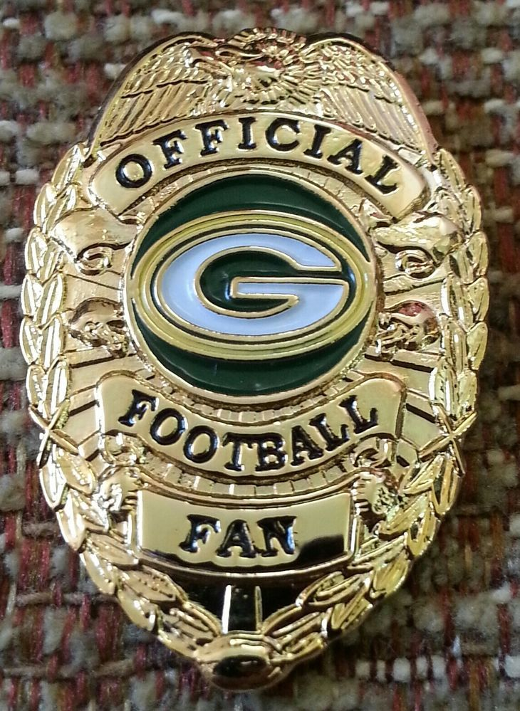 Green Bay Packers official football fan badge pin.