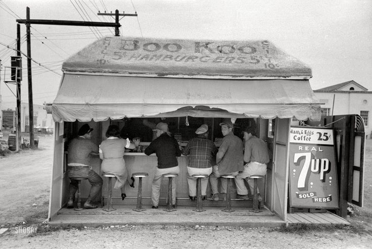 """February 1939. """"Hamburger stand in Harlingen, Texas."""" Burgers 5 cents, chili a dime, breakfast two bits, the 7up is real."""