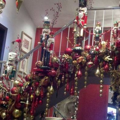Nutcrackers & Ornaments Christmas stair garland - love the dangling ornaments