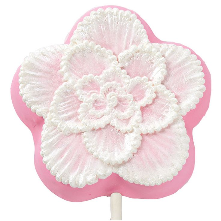 Add textured flowers with the soft look of lace using this easy icing technique. Works best using a square tip brush.