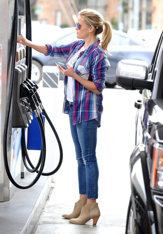 Reese Witherspoon in a plaid top, skinny jeans, and booties - celebrity street style in Brentwood, California