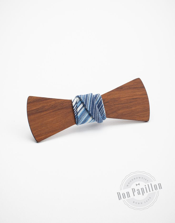 Don Sanz feels an exotic accessory from the bold blue stripped fabric to the brown- reddish teak wood
