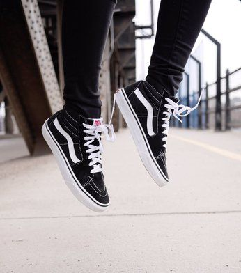 Style blogger of The Pretty Secrets, Sandy Joe Karpetz getting air in her Sk8-Hi's.