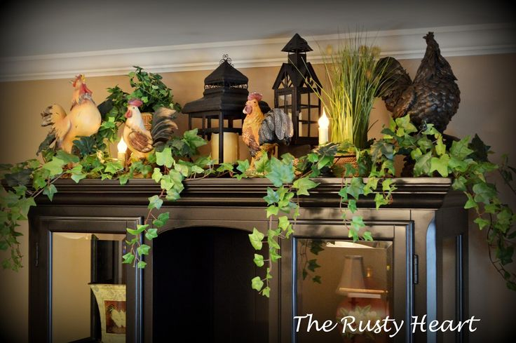 Rusty Heart Designs....I like the lanterns and the ivy.  I'd just replace the roosters with something else.