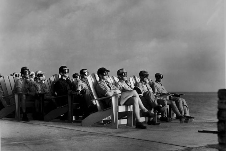 VIP observers are lit up by the light of an atomic bomb, Operation Greenhouse, Enewetak Atoll, 1951