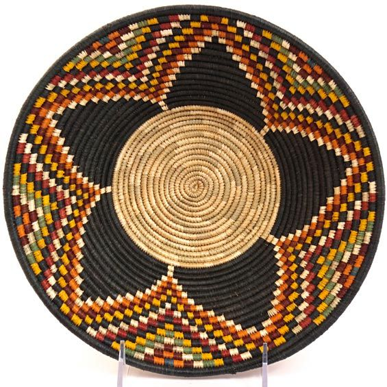 Africa | Rwenzori Bowl basket woven by the women in Southern Uganda. | Baskets are woven from discarded Millet stalks, naturally dyed raffia and sometimes local grasses. The natural portions are dried millet leaves. The vibrant natural dyes used on the raffia for these tightly woven baskets come from flowers, roots, leaves and lichens grown by the weavers themselves.