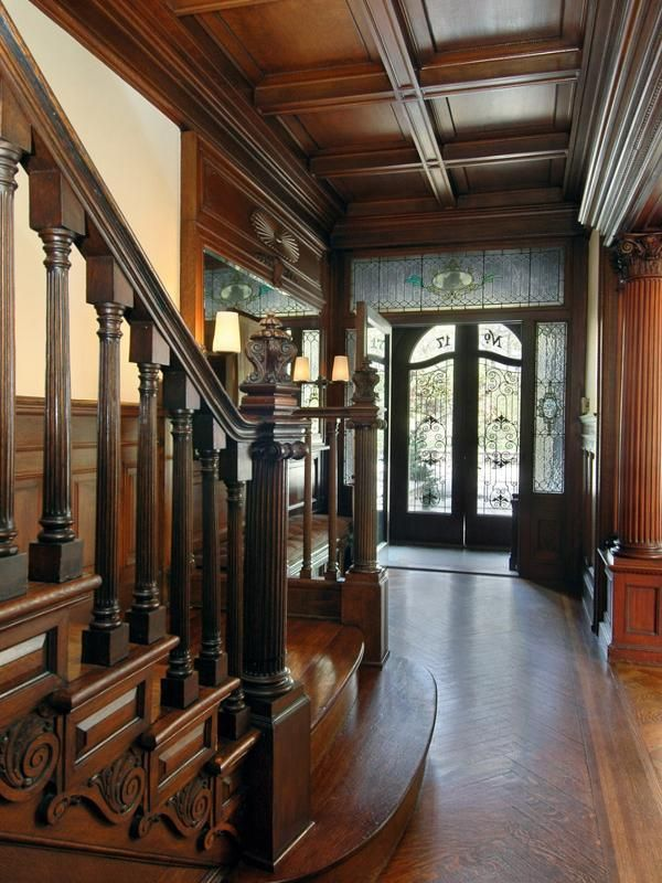 Oh, my!  I'm so in love with this gorgeous foyer!  Amazing wood detail and look at that door.