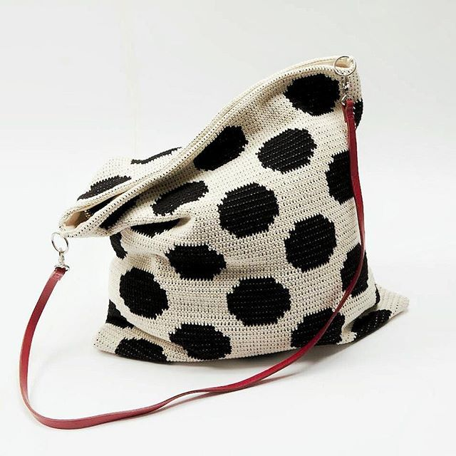 Dotted bag!! Even before making #virkkuri books I had this thing for dots. Now they are all over in my books too, just making a dotted crochet work here for the new kids crochet book. This one is the same bag than in the previous photo in my feed, pattern in the book 2. :) Photo by Saara Salmi. #makingofvirkkuribooks #mollamillscrochetterie #crochet #crochetallthethings #dots #somered