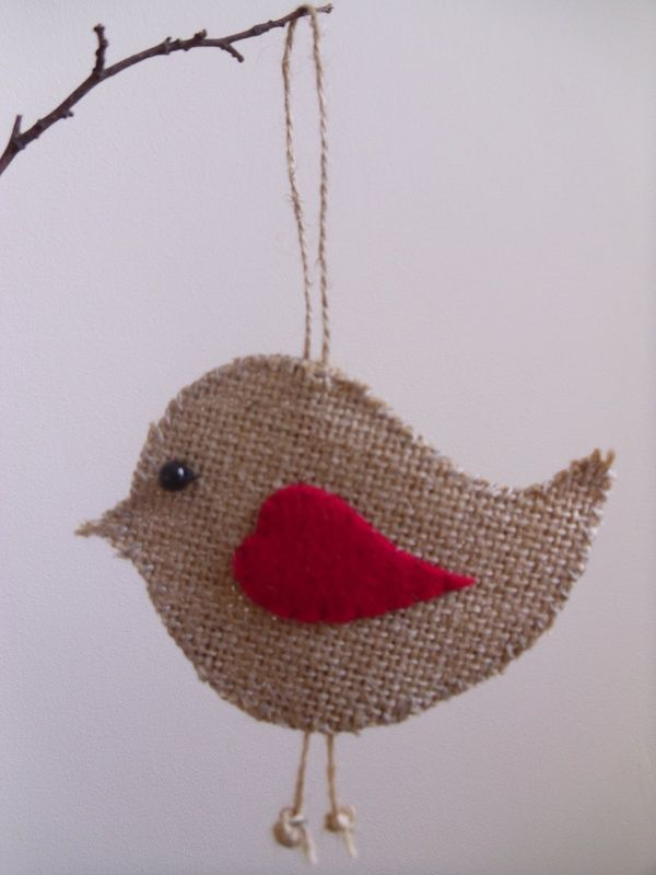 Loving the idea of a few little burlap birds decorated with colored buttons hanging from a branch!