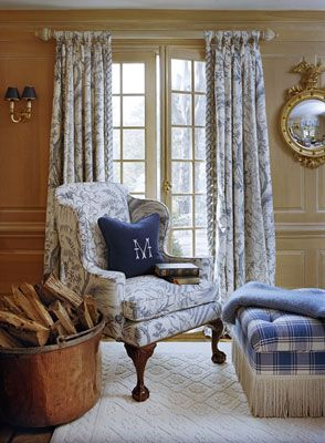 drapes, Federal mirror, sconces, colors, copper kettle, monogrammed pillow, fringed ottoman, carpet, paneling, chair....love