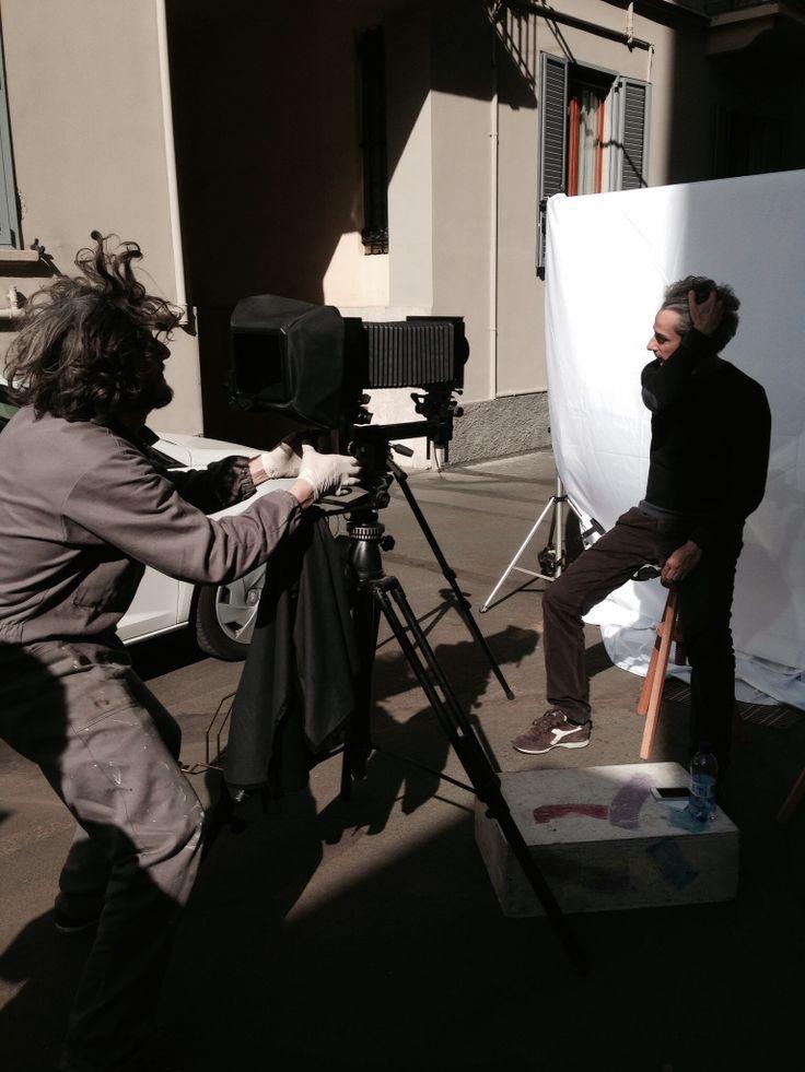 Photographer Carlo Furgeri Gilbert at work, shooting Matteo for one of his tintype cycle. Milan april 2014
