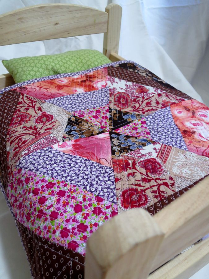 Dolly bed quilt from scraps