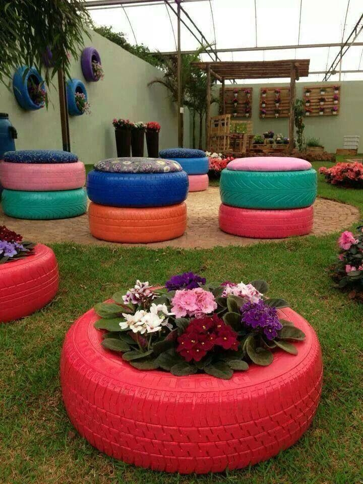 Sprayed tire planters & outdoor chairs.