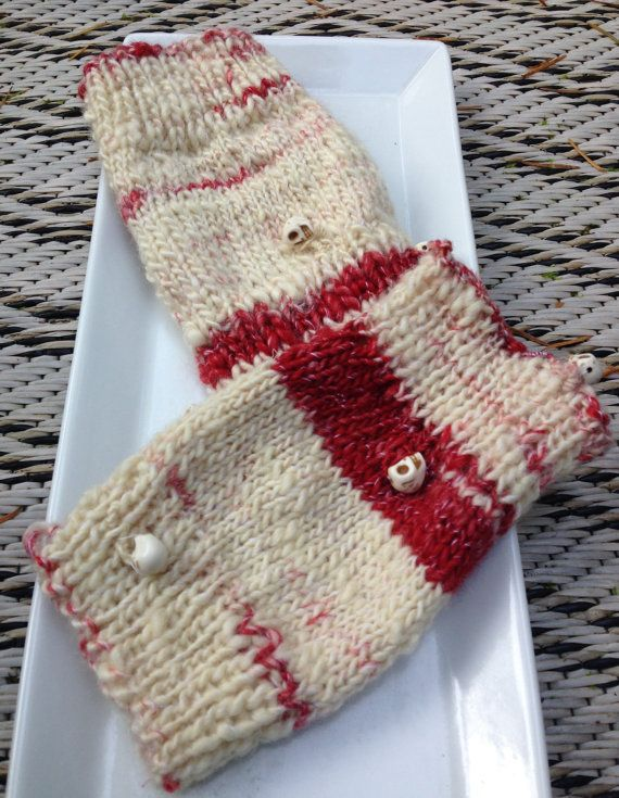 A pair of 5 inch short wrist warmers hand knitted by WoolnLove