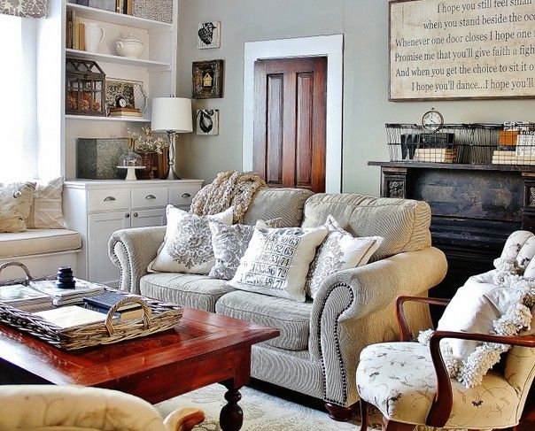 There's a couple things I like here....the white trim around the dark door...the mix of wood stains and white painted furniture...the collection of things in the bookshelves...a nice mix.  cozy.