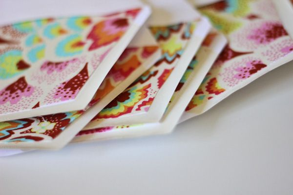 This post was originally posted at Ucreate a few months ago. But I'm reposting it in case you missed it! You should do this to your Christmas card envelopes.DIY lined envelopes with fabric and paper scraps! I have a big scrap pile and I wanted to use up at least a little of it. So …
