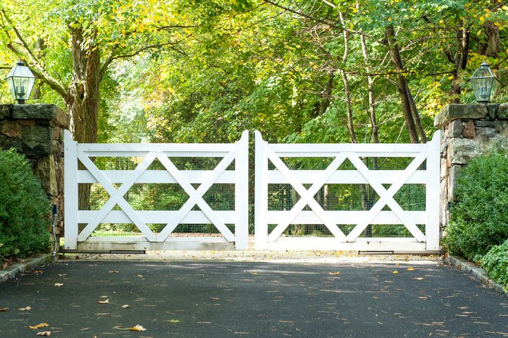We designed this updated twist on the classic ranch-style driveway gate. Notice how the doubled-up cross beams (x's) and taller height makes this design work for country-style properties and modern homes alike.