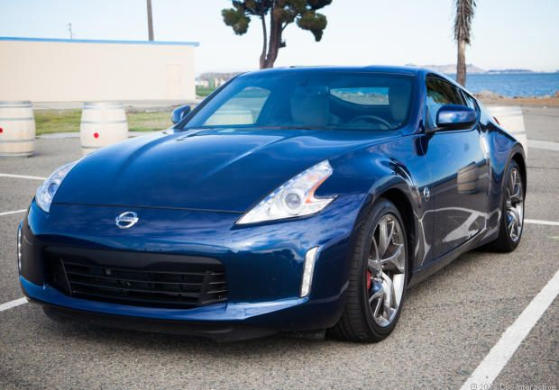 Nissan Z-car eats up the road, beats up the driver