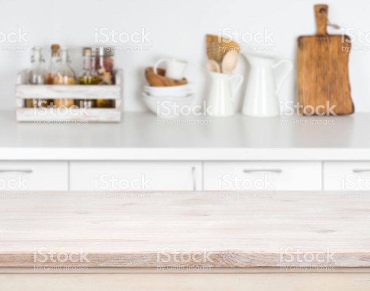 Light wood table with bokeh image of kitchen counter interior foto stock royalty-free
